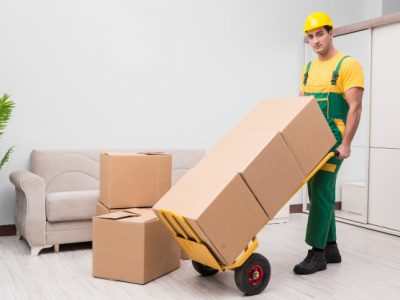 man-delivering-boxes-during-house-move_85869-4436